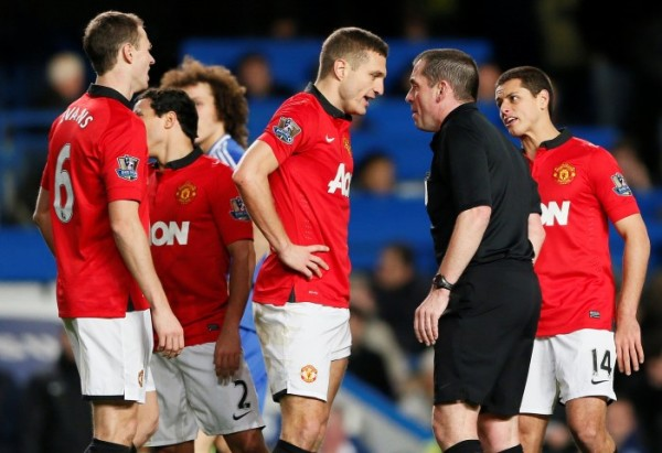 Manchester United's Vidic talks referee Dowd after being sent off during their English Premier League soccer match against Chelsea at Stamford Bridge
